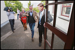 Sinn Fein's Party leader Gerry Adams arrives to cast his vote for local and European Elections at Doolargy National School in Ravensdale, County Louth, Ireland,  Friday May 23rd. Polling stations will remain open until 10pm. Almost 2,000 candidates are contesting the 949 local authority seats, while 41 hopefuls are in the race for 11 MEP seats spread over three constituencies while counting has begun in the local elections in Northern Ireland. Over 900 candidates are competing for the 462 seats on 11 new local authorities. Final results are expected to be known by tomorrow afternoon. Counting in the European Elections begins in Belfast on Monday morning. Friday, 23rd May 2014. Picture by  i-Images / i-Images