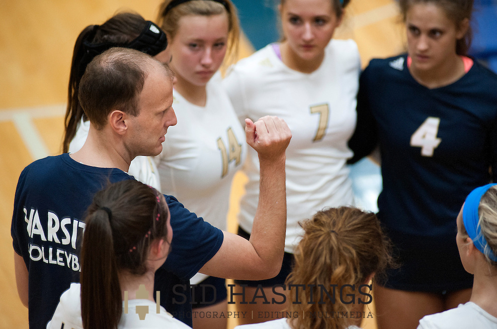 25 AUG. 2015 -- ST. CHARLES, Mo. -- Volleyball players from St. Pius X High School listen as coach Dustin Cutts (left) addresses the team during a timeout in their match with Duchesne High School at Duchesne in St. Charles, Mo. Tuesday, Aug. 25, 2015. St. Pius won, 2-0 (25-14, 25-23), to advance to 6-0. It was Duchesne's first match, dropping them to 0-1 on the year. Photo © copyright Sid Hastings.