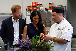 The Duke and Duchess of Sussex look at traditional native Australian ingredients during a visit to Mission Australia social enterprise restaurant Charcoal Lane in Melbourne, on the third day of the royal couple's visit to Australia.