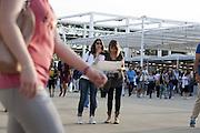 Visitors consult the map of the exhibition site just entered in Expo 2015, Rho-Pero, June, 2015. &copy; Carlo Cerchioli<br /> <br /> Visitatrici consultano la cartina del sito espositivo appena entrate a Expo 2015, Rho-Pero, giugno, 2015