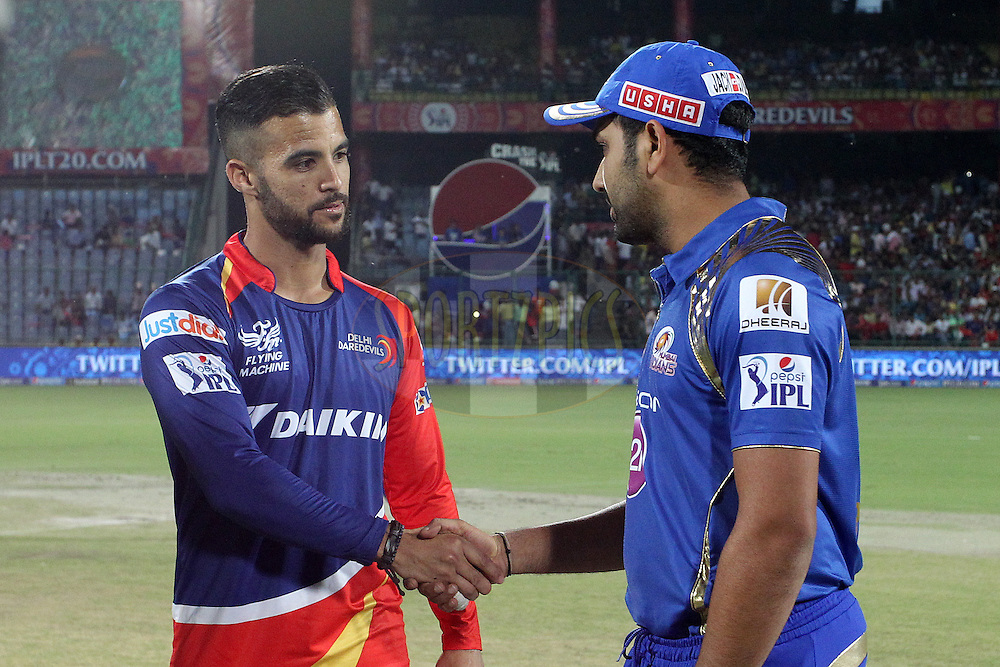 Delhi Daredevils captain Jean-Paul Duminy and Mumbai Indians captain Rohit Sharma shake hands after the toss during match 21 of the Pepsi IPL 2015 (Indian Premier League) between The Delhi Daredevils and The Mumbai Indians held at the Ferozeshah Kotla stadium in Delhi, India on the 23rd April 2015.<br /> <br /> Photo by:  Shaun Roy / SPORTZPICS / IPL