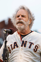 SAN FRANCISCO, CA - AUGUST 05: Recording artist Bob Weir of the Grateful Dead sings the national anthem before the game between the San Francisco Giants and the Milwaukee Brewers at AT&T Park on August 5, 2013 in San Francisco, California. The San Francisco Giants defeated the Milwaukee Brewers 4-2. (Photo by Jason O. Watson/Getty Images) *** Local Caption *** Bob Weir