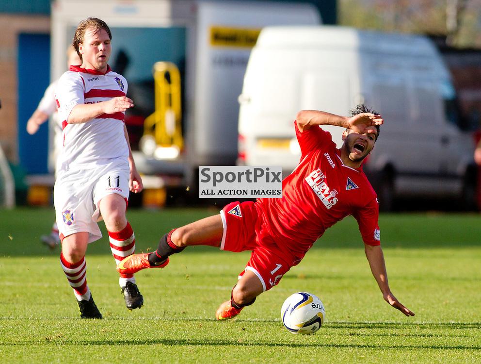 Stirling Albion v Dunfermline Athletic SPFL League One Forthbank Stadium 04 October 2014<br /> Faissal El Bakhtaoui is fouled<br /> CRAIG BROWN | sportPix.org.uk