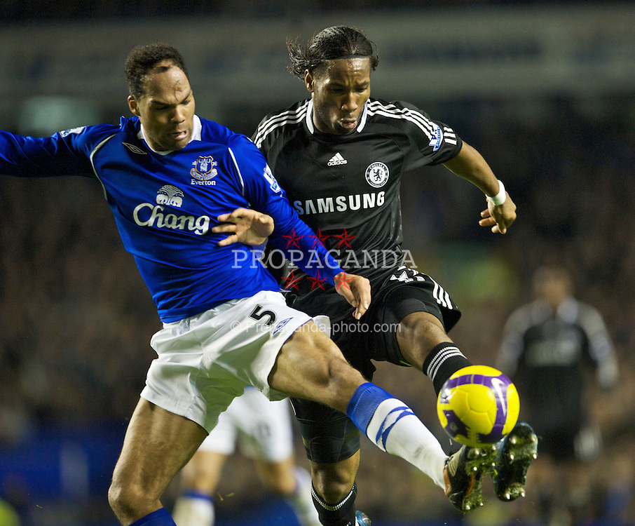 LIVERPOOL, ENGLAND - Monday, December 22, 2008: Everton's Joleon Lescott and Chelsea's Didier Drogba during the Premiership match at Goodison Park. (Photo by David Rawcliffe/Propaganda)