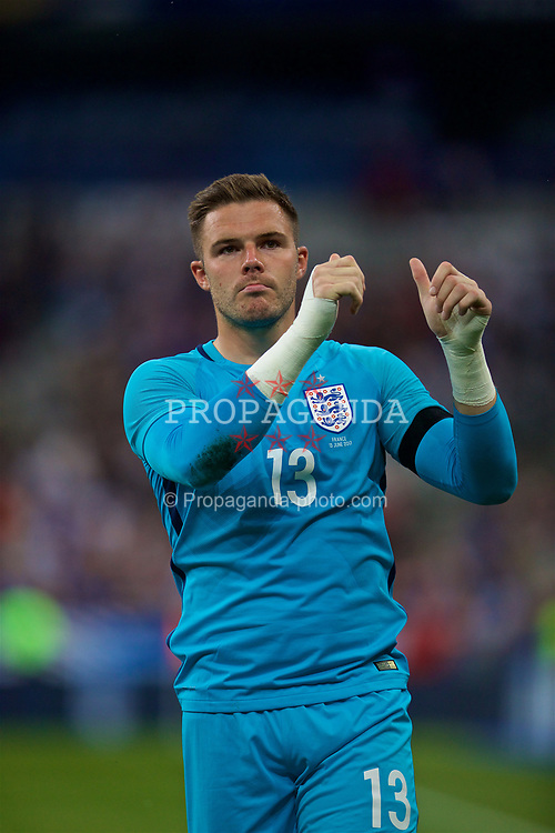 PARIS, FRANCE - Tuesday, June 13, 2017: England's goalkeeper Jack Butland looks dejected as his side lose 3-2 to France during an international friendly match at the Stade de France. (Pic by David Rawcliffe/Propaganda)