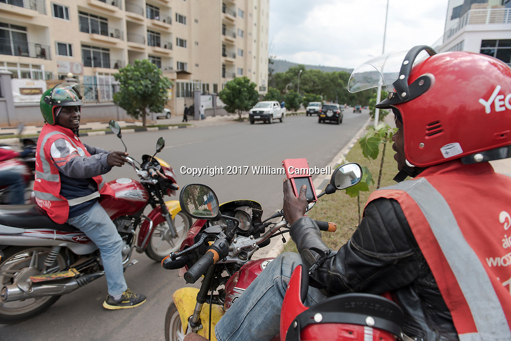 KIGALI, RWANDA-OCT 16:  Moto taxi drivers are connected with cell data in downtown Kigali, the capital of Rwanda. The country has almost universal cell overage Since the 1994 genocide that killed at least 800,000 Rwanda has experienced unprecedented development with a major building boom in the capital. (Photo by William Campbell-Corbis via Getty Images)