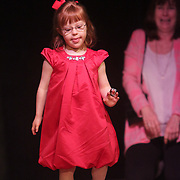 Bitty Wright walks the runway during the I Am Beautiful fashion show to benefit the Miracle League of Wilmington. (Jason A. Frizzelle)