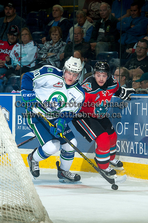 KELOWNA, CANADA - OCTOBER 7: Colby Cave #10 of Swift Current Broncos skates with the puck around the net as Colten Martin #8 of Kelowna Rockets checks him during second period on October 7, 2014 at Prospera Place in Kelowna, British Columbia, Canada.  (Photo by Marissa Baecker/Getty Images)  *** Local Caption *** Colten Martin; Colby Cave;