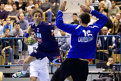 Jure Dobelsek of Slovenia vs Hugo Laurentino of Portugal during handball match between National teams of Slovenia and Portugal in the Qualifications of the EHF EURO 2012, on October 27, 2010 at Arena Zlatorog, Celje, Slovenia. Slovenia defeated Portugal 34 - 31.(Photo By Vid Ponikvar / Sportida.com)
