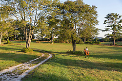 A woman rides her horse on Sagamore Hill in Hamilton, Massachusetts.
