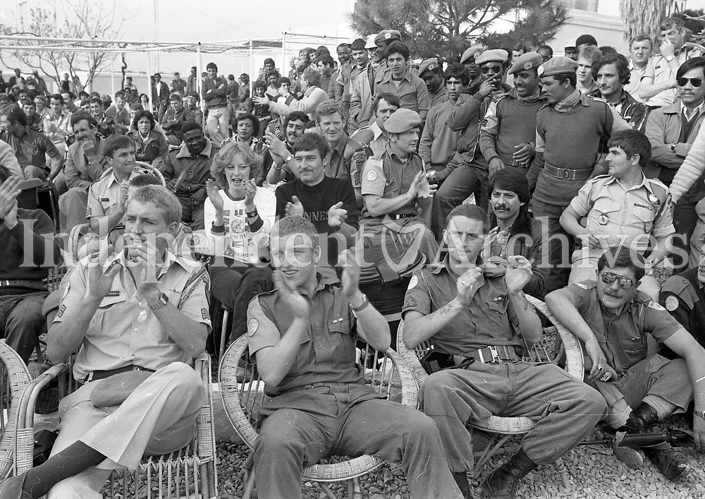 Soldiers from all contingents enjoying one of Geraldine Branigan's concerts whilst visiting Irish troops in the Lebanon. March 14, 1980. (Part of the Independent Newspapers/NLI Collection)