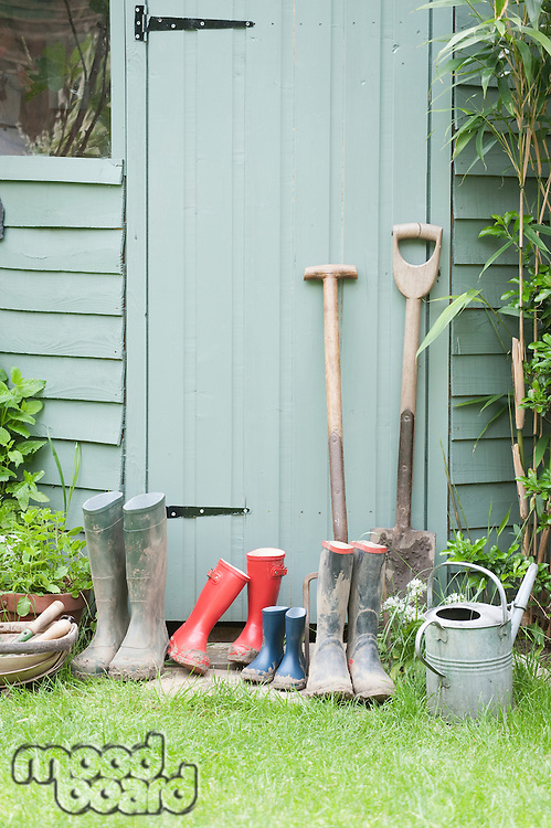 Gardening tools at door of potting shed