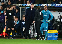 Kristoffer Nordfeldt of Swansea City waits to come on the field next to Swansea City manager Paul Clement but Lukasz Fabianski of Swansea City refuses to be substituted. - Mandatory by-line: Alex James/JMP - 05/04/2017 - FOOTBALL - Liberty Stadium - Swansea, England - Swansea City v Tottenham Hotspur - Premier League