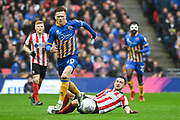 Jon Nolan of Shrewsbury Town (20) and Lee Frecklington of Lincoln City (19) battle for the ball during the EFL Trophy Final match between Lincoln City and Shrewsbury Town at Wembley Stadium, London, England on 8 April 2018. Picture by Stephen Wright.