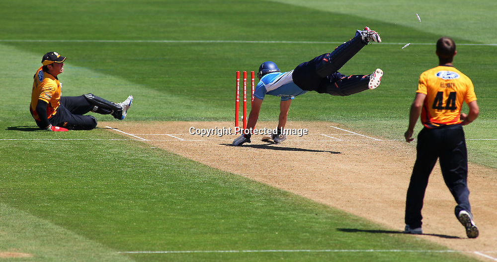 Brad Cachopa is run out by Brendan Taylor during their Twenty20 Cricket match - HRV Cup, Wellington Firebirds v Auckland Aces, 28 December 2011, Hawkins Basin Reserve, Wellington. . PHOTO: Grant Down / photosport.co.nz