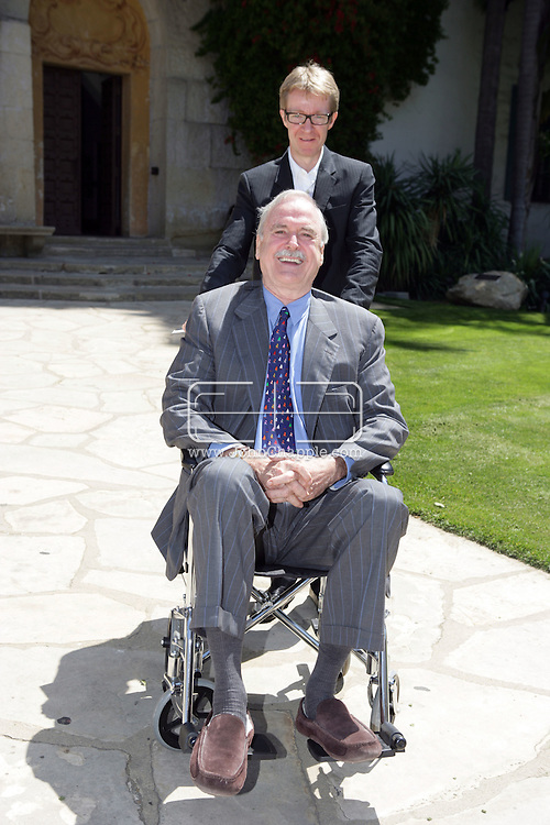 EXCLUSIVE..13th May 2008, Santa Barbara, California. Actor John Cleese arrives at Santa Barbara court house for his divorse hearing. The aging British, Monty Python star arrived in a wheelchair and showed off his scars from a recent knee operation. John is pictured with his assistant Garry Scott-Irvine. PHOTO © JOHN CHAPPLE / REBEL IMAGES.john@chapple.biz     www.chapple.biz