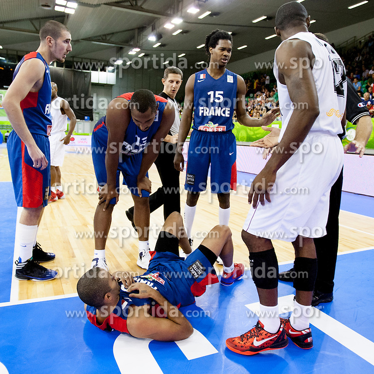 Tony Parker #9 of France injured during basketball match between National teams of France and Belgium at Day 6 of Eurobasket 2013 on September 9, 2013 in Tivoli Hall, Ljubljana, Slovenia. (Photo By Urban Urbanc / Sportida)