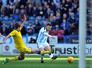 Harry Bunn of Huddersfield Town shoots for goal against Leeds United during the Sky Bet Championship match at the John Smiths Stadium, Huddersfield<br /> Picture by Graham Crowther/Focus Images Ltd +44 7763 140036<br /> 07/11/2015
