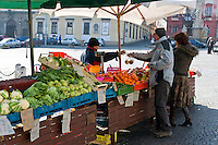 BRNO, CZECH REPUBLIC - MARCH 5th 2011: Photo of locals buying in the Vegetables Market in Brno. From the time immemorial this place has hosted regular daily fairs where the people come to buy vegetables, fruit, flowers, etc. Brno is the 2nd largest city in the Czech Republic and a very popular tourist destination. EDITORIAL USE ONLY.