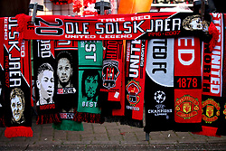 A general view of a street vendor selling commemorative scarves outside Old Trafford Stadium prior to the beginning of the match
