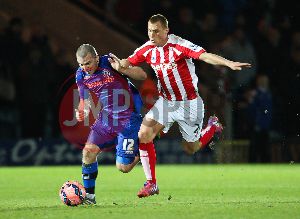 Rochdale's Stephen Dawson is fouled by Stoke City's Steve Sidwell - Photo mandatory by-line: Matt McNulty/JMP - Mobile: 07966 386802 - 26/01/2015 - SPORT - Football - Rochdale - Spotland Stadium - Rochdale v Stoke City - FA Cup Fourth Round