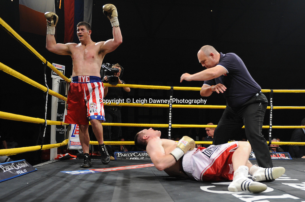 Tye Fields (USA/Canadian shorts) delivers a devastating blow to the chest of Konstantin Airich in Semi Final 2 at Prizefighter International on Saturday 7th May 2011. Prizefighter / Matchroom. Photo credit © Leigh Dawney. Alexandra Palace, London.