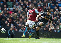 BIRMINGHAM, ENGLAND - Easter Sunday, March 31, 2013: Liverpool's captain Steven Gerrard in action against Aston Villa's Yacouba Sylla during the Premiership match at Villa Park. (Pic by David Rawcliffe/Propaganda)