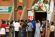 People line up to enter a pavilion at the 22nd Salon International de l'Artisanat de Ouagadougou (SIAO) in Ouagadougou, Burkina Faso on Saturday November 1, 2008.