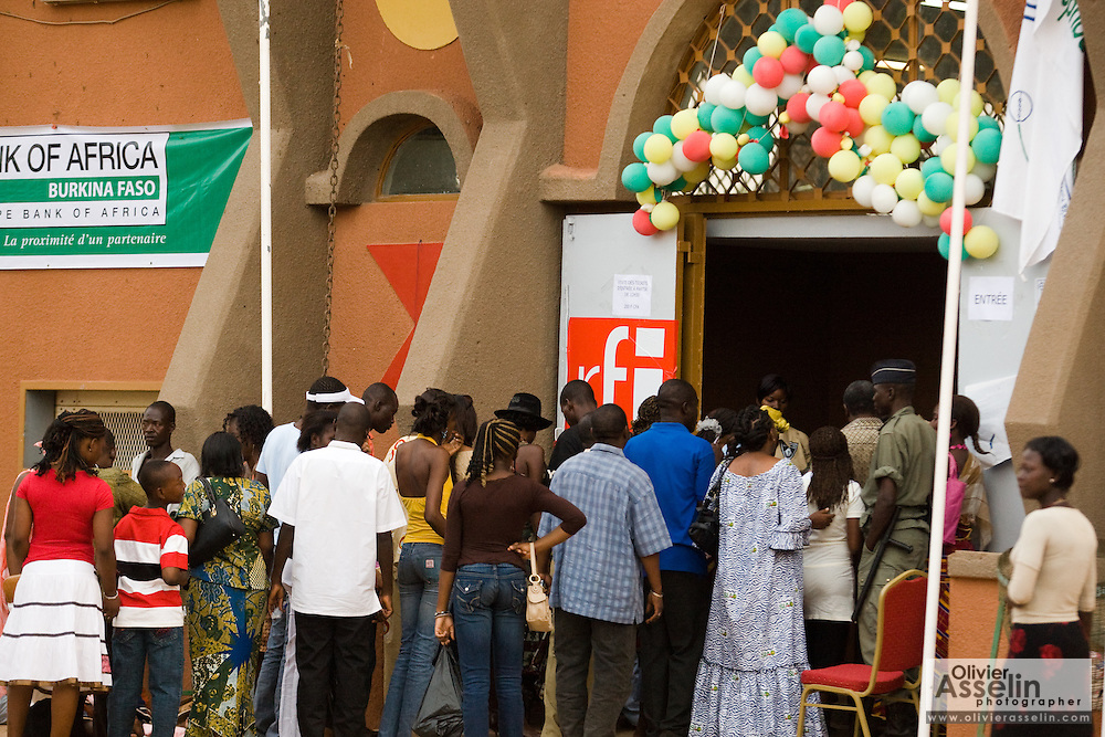 People line up to enter a pavilion at the 22nd Salon International de l'Artisanat de Ouagadougou (SIAO) in Ouagadougou, Burkina Faso on Saturday November 1, 2008.