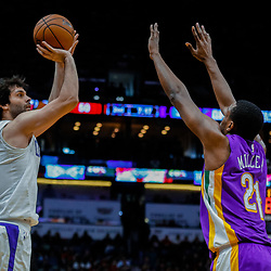 Jan 28, 2018; New Orleans, LA, USA; LA Clippers guard Milos Teodosic (4) shoots over New Orleans Pelicans forward Darius Miller (21) during the second quarter at the Smoothie King Center. Mandatory Credit: Derick E. Hingle-USA TODAY Sports