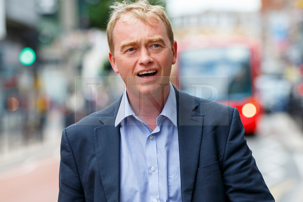 © Licensed to London News Pictures. 29/07/2015. Surrey, UK. Newly elected Liberal Democrat leader Tim Farron visits Banquet Records in Kingston upon Thames and meets two new Liberal Democrat councillors who have each won by-elections since the General Election on Wednesday, July 29, 2015. Photo credit: Tolga Akmen/LNP
