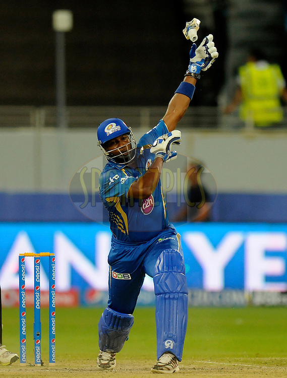 Kieron Pollard of the Mumbai Indians looses his grip over his bat as he  bats during match 20 of the Pepsi Indian Premier League Season 2014 between the Mumbai Indians and the Sunrisers Hyderabad held at the Dubai International Stadium, Dubai, United Arab Emirates on the 30th April 2014<br /> <br /> Photo by Pal Pillia / IPL / SPORTZPICS