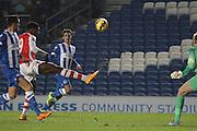 Chuba Akpom lobs Brighton Goalkeeper Christian Walton during the Barclays U21 Premier League match between Brighton U21 and Arsenal U21 at the American Express Community Stadium, Brighton and Hove, England on 1 December 2014.