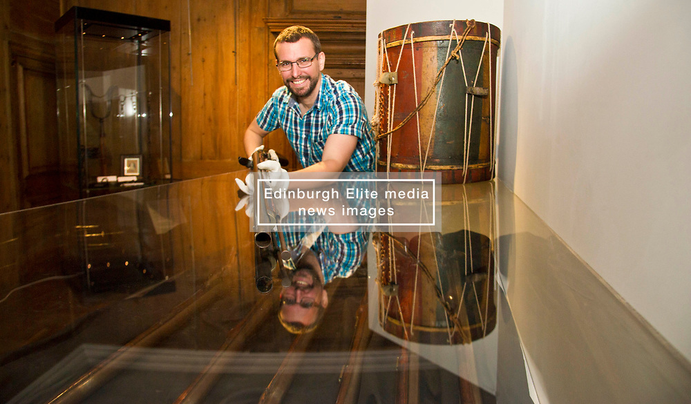 Pictured: Curator Nico Tyack handles an 18th century musket with care<br /> <br /> The latest Museum of Edinburgh exhibition documents the history of Edinburgh's Town Guard, which brought law and order to the city in the 18th century. Curator Nico Tyack and Museum Assistant David Mclay examined muskets, halberds and drums before the exhibition was opened to the public<br /> <br /> Ger Harley | EEm 15 June 2017