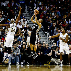 Mar 3, 2017; New Orleans, LA, USA; San Antonio Spurs guard Tony Parker (9) shoots over New Orleans Pelicans forward Dante Cunningham (33) during the second quarter of a game at the Smoothie King Center. Mandatory Credit: Derick E. Hingle-USA TODAY Sports