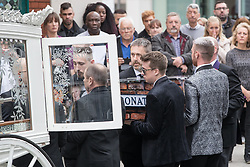 © Licensed to London News Pictures . 30/06/2017 . Stockport , UK . Martyn's coffin is carried in to the Town Hall . The funeral of Martyn Hett at Stockport Town Hall . Martyn Hett was 29 years old when he was one of 22 people killed on 22 May 2017 in a murderous terrorist bombing committed by Salman Abedi, after an Ariana Grande concert at the Manchester Arena . Photo credit : Joel Goodman/LNP