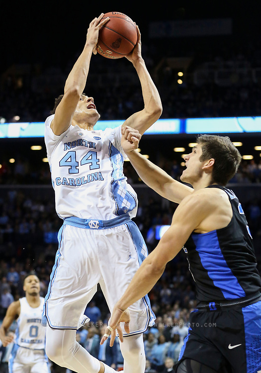 North Carolina forward Justin Jackson (44) shoots the ball over Duke guard Grayson Allen (3) during the semifinals of the 2017 New York Life ACC Tournament at the Barclays Center in Brooklyn, N.Y., Friday, March 10, 2017. (Photo by David Welker, theACC.com)