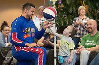 Oliver Nimmo, 4, gets wide-eyed as El Gato Melendez, star of the world famous Harlem Globetrotters, spins a ball on his finger while visiting children at the Durham Outpatient Center on Monday, March 26, 2018, in Omaha.<br /> <br /> MATT DIXON/THE WORLD-HERALD
