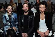 Sofia Sanchez Barrenechea, left, Max Snow, center, and Lily Kwong pose for a photograph before the Altuzarra Fall 2014 collection is presented during Fashion Week in New York, Saturday, Feb. 8, 2014. (AP Photo/Diane Bondareff)