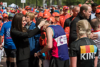 TRH The Duke and Duchess of Cambridge and Prince Harry hand out medals to runners after the finish line. The Virgin Money London Marathon, 23rd April 2017.<br /> <br /> Photo: Karwai Tang for Virgin Money London Marathon<br /> <br /> For further information: media@londonmarathonevents.co.uk