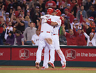 The Angels' Albert Pujols celebrates with Mike Trout after his sacrifice fly beat the Colorado Rockies 2-1 Wednesday night at Angel Stadium.