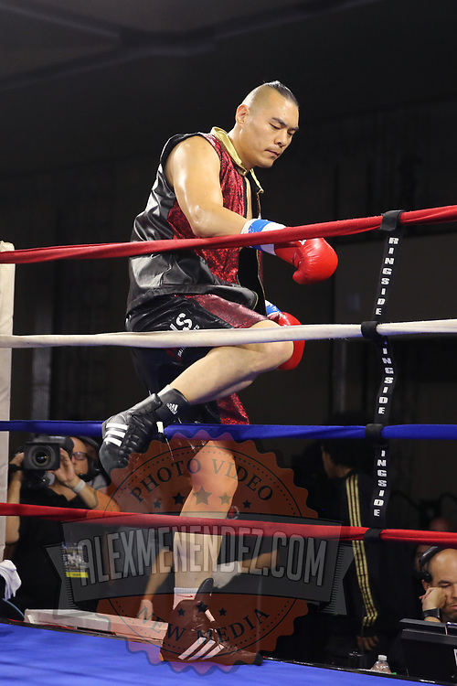 Zhilei Zhang of Zhoukou, China steps in to the ring as he prepares to face Curtis Harper of Jacksonville, Florida during a Nelsons Promotions boxing match at the Boca Raton Resort  and Club on Friday, May 26, 2017 in Boca Raton, Florida.  (Alex Menendez via AP)