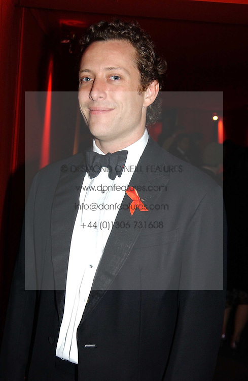 "TOBY ROWLANDS at the 10th annual British Red Cross London Ball.  This years ball theme was Indian based - ""Yaksha - Yakshi: Doorkeepers to the Divine"" and was held at The Room, Upper Ground, London on 1st December 2004.  Proceeds from the ball will aid vital humanitarian work, including HIV/AIDS projects that the Red Cross supports in the UK and overseas.<br />