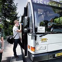Nederland,Wageningen ,2 juni 2008..Leerlingen van  ROC Rijn IJsel staan bij een speciaal ingehuurde schoolbus vanwege de streekvervoer stakingen..Students taking a hired bus, because the Public Transport was on strike.
