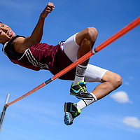 050214       Cable Hoover<br /> <br /> Ramah Mustang Tevin Bowekaty clears 5' in the high jump during the district 1-2A track meet Friday at Ramah High School.