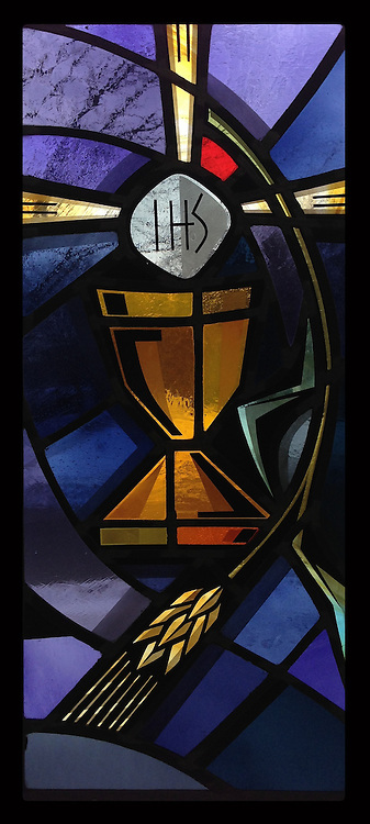 Stained glass depicting the chalice and consecrated host. Taken with iPhone5 at Holy Rosary Church in Kewaunee. (Sam Lucero photo)