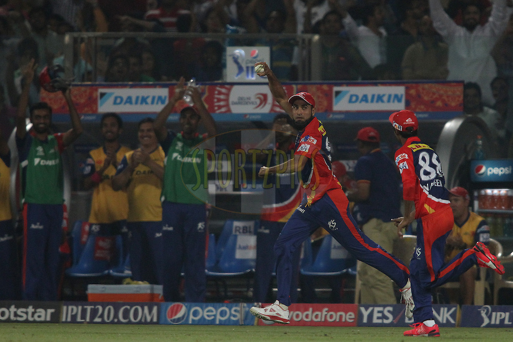 Imran Tahir of the Delhi Daredevils celebrates after taking the catch to get Parthiv Patel of Mumbai Indians wicket during match 21 of the Pepsi IPL 2015 (Indian Premier League) between The Delhi Daredevils and The Mumbai Indians held at the Ferozeshah Kotla stadium in Delhi, India on the 23rd April 2015.<br /> <br /> Photo by:  Shaun Roy / SPORTZPICS / IPL