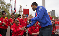 Tottenham and England star Andros Townsend presents a trophy to Shelby Watson, winner of the girls U17 Wheelchair race in the Virgin Giving Mini London Marathon, Sunday 26th April 2015.<br />