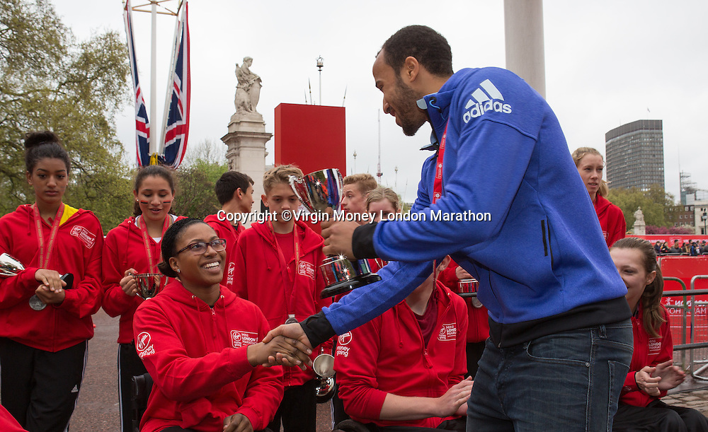 Tottenham and England star Andros Townsend presents a trophy to Shelby Watson, winner of the girls U17 Wheelchair race in the Virgin Giving Mini London Marathon, Sunday 26th April 2015.<br /> <br /> Neil Turner for Virgin Money London Marathon<br /> <br /> For more information please contact Penny Dain at pennyd@london-marathon.co.uk