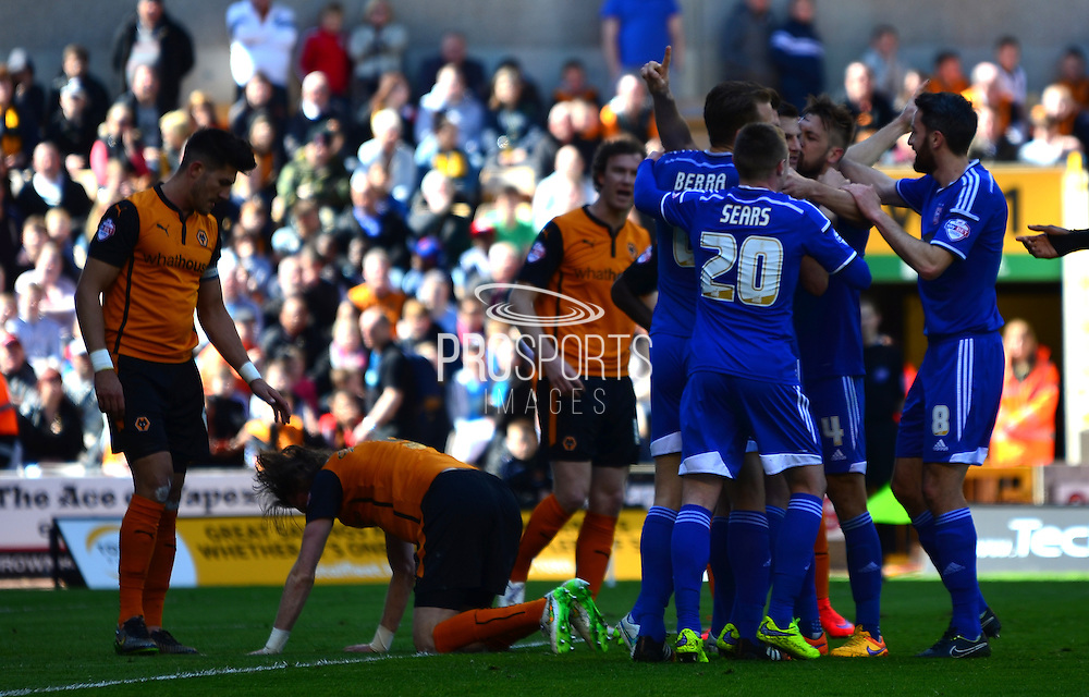 Ricahrd Stearman's own goal is celebrated by the Ipswich players during the Sky Bet Championship match between Wolverhampton Wanderers and Ipswich Town at Molineux, Wolverhampton, England on 18 April 2015. Photo by Alan Franklin.